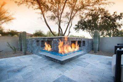 A corner wall fireglass burner setup